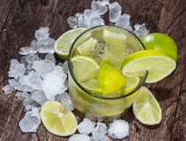 Caipirinha with Crushed Ice on wood Stock Photos