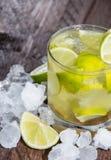 Caipirinha with Crushed Ice on wood Royalty Free Stock Image