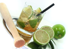 Caipirinha with fresh lime Stock Images