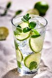 Caipirinha, Mojito cocktail, vodka or soda drink with lime, mint and straw on sand background. Still life. Copy space royalty free stock photography