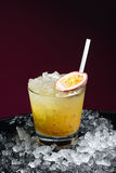 Caipirinha with passion fruit Stock Images