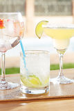 Caipirinha, strawberry gin and tonic and margarita cocktails by Royalty Free Stock Photo
