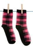 Cair de duas peúgas na corda Fotografia de Stock Royalty Free