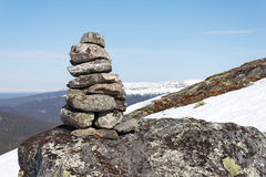 Cairn. In the mountains against the blue sky stock photography