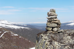 Cairn. In the mountains against the blue sky royalty free stock photography
