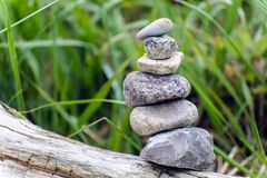 Cairn before beach grass Royalty Free Stock Photo