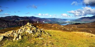 Cairn on Bleaberry Fell. Bleaberry Cairn over Derwent and Bassenthwaite royalty free stock images