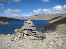 Cairn. Buddhist stupa, choyten. Cairn. Buddhist stupa, choyten on a mountaintop above the river Royalty Free Stock Images
