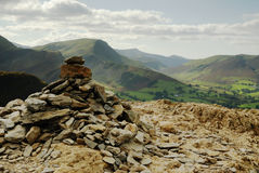 Cairn on Cat Bells. The Carin on top of Cat Bells looking to the Derewnt Fells Royalty Free Stock Images