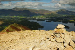 Cairn on Cat Bells. The Carin on top of Cat Bells looking over Derwent water to Blencathra Stock Image