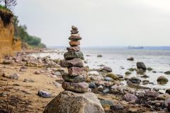 Cairn in front of the cliff Stock Image