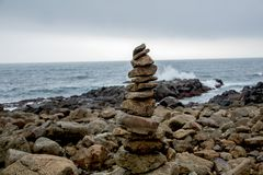 Cairn in front of coastal landscape stock image