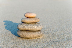 Cairn on a gray sand Stock Photo