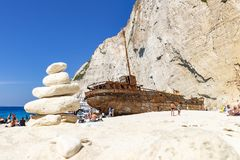 A Cairn is located in front of the ship wreck on Navagio Beach on the island of Zakynthos, Greece royalty free stock photos