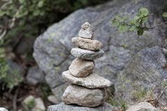 Cairn made of grey granite stones. A cairn human-made pile made of grey granite stones royalty free stock photography