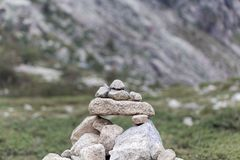 Cairn made of grey granite stones. A cairn human-made pile made of grey granite stones stock images