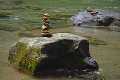 A cairn marks the presence of a visitor of the La Fortuna River in Costa Rica. royalty free stock photos