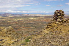 Cairn in the McCullough Peaks badlands. The McCullough Peaks deserts of north western Wyoming has extreme climate in summer and winter, and is forbiddingly dry stock photos