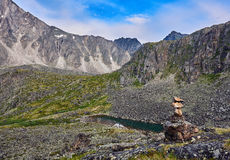 Cairn in mountain tundra Stock Images