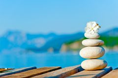 A cairn on the pier. On the sea background royalty free stock image