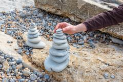 Pyramid of stones. Cairn, Pyramid of stones on the sea Royalty Free Stock Image