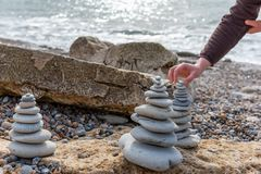 Pyramid of stones. Cairn, Pyramid of stones on the sea Stock Photos