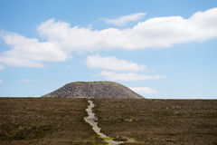 Cairn of Queen Meave's Tomb, Sligo. The hilltop cairn at the summit of Knocknarea, Sligo, Ireland Royalty Free Stock Photography