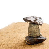 Cairn in the sand is isolated Royalty Free Stock Photos