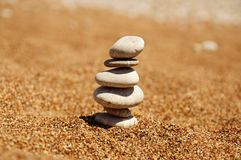 Cairn on the sand Stock Photography