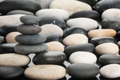 Cairn stands on the white and black stones Stock Photography