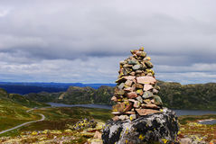 Cairn (stone pile). A cairn (stone pile) at a mountain top Stock Photo