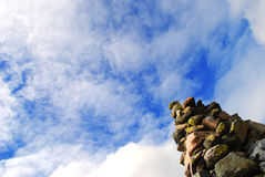 Cairn (stone pile). A cairn (stone pile) under a blue sky Royalty Free Stock Photo