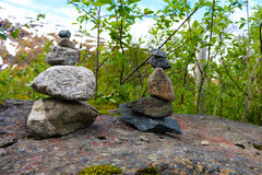 Cairn stones on rock. Cairn stones as markers on rock ledge stock photo