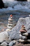 Cairn by the stream Stock Photo