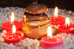 Cairn surrounded by candles Stock Photos