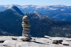 Cairn on the top of Half Dome. Cairn on the plateau on  the top of Half Dome peak Royalty Free Stock Photography