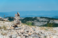 Cairn on top of a mountain. Overlooking the valley Royalty Free Stock Images