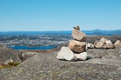 Cairn with the view of fjord. Cairn on the rock  with the view of fjord royalty free stock photography