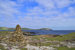 Cairn view. Cairn on the Ness of Burgi, south Shetland, Scotland, looking east across the Voe to Sumburgh Lighthouse stock images