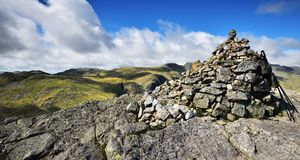 Cairn and walking poles Stock Images
