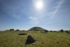 Cairnpapple Hill, West Lothian, Scotland. Sun shines in blue sky over the ancient ritual site of Cairnpapple Hill in West Lothian Scotland Stock Photos