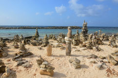 Cairns in Aruba on the Beach. Stone cairns found on the beach in Aruba Royalty Free Stock Images
