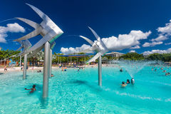 CAIRNS; AUSTRALIA - 17 APRIL 2017. Tropical swimming lagoon on t. He Esplanade in Cairns with artificial beach; Queensland; Australia Royalty Free Stock Photos