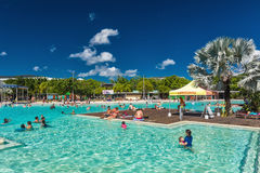 CAIRNS; AUSTRALIA - 17 APRIL 2017. Tropical swimming lagoon on t. He Esplanade in Cairns with artificial beach; Queensland; Australia Stock Photo