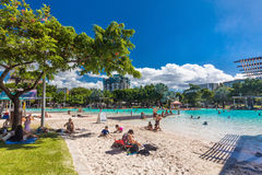 CAIRNS; AUSTRALIA - 17 APRIL 2017. Tropical swimming lagoon on t. He Esplanade in Cairns with artificial beach; Queensland; Australia Royalty Free Stock Photo