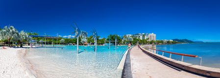 CAIRNS, AUSTRALIA - 27 MARCH 2016. The Esplanade in Cairns with. Swimming lagoon and the ocean, Queensland, Australia Stock Photography