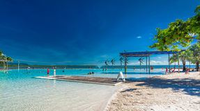 CAIRNS, AUSTRALIA - 27 MARCH 2016. Tropical swimming lagoon on t. He Esplanade in Cairns with artificial beach, Queensland, Australia Stock Photos