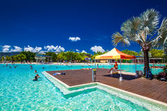 CAIRNS, AUSTRALIA - 27 MARCH 2016. Tropical swimming lagoon on t Stock Photos