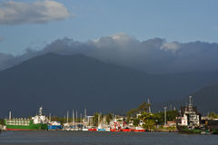Cairns boat whalf. Container and boats docked in Cairns habor royalty free stock photography