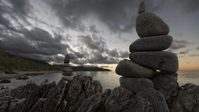 Cairns in Cairns. Rock cairns along the road at sunset stock photography